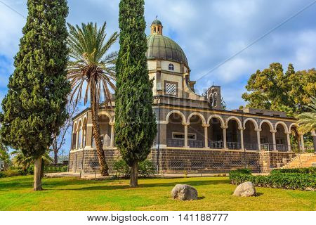 Israel, the shores of Lake Kinneret. Catholic monastery and a small church Mount of Beatitudes. Beautiful park of cypress and palm trees
