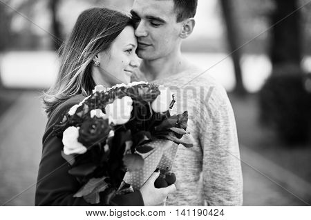 Marriage Proposal. Man With His Girlfriend. Black And White Photo