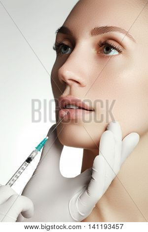 Lips Operated By Plastic Surgeon. Beauty Injection By Doctor In