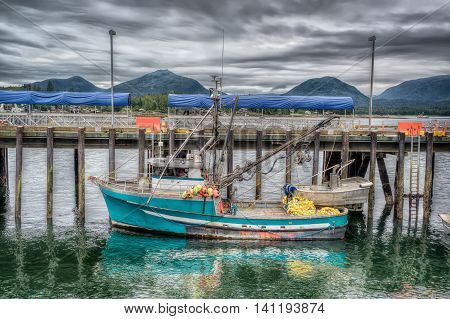 Colorful commercial fishing boat docked in Ketchikan Alaska