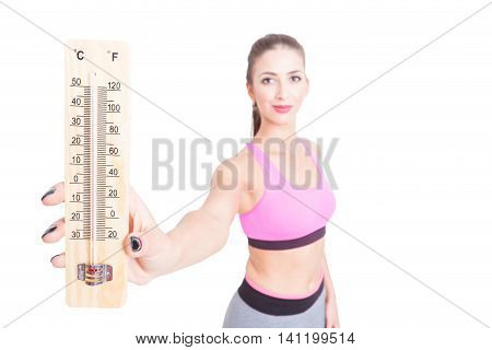 Woman At Gym Showing Thermometer Being High