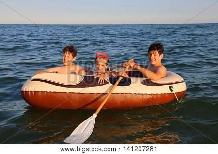 Three Brothers On The Inflatable Dinghy