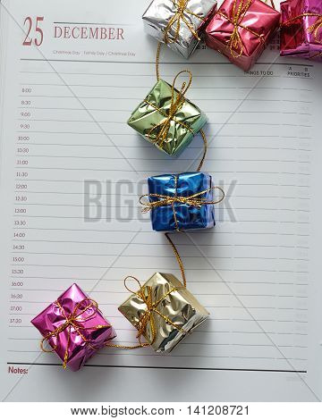 Diary open on the 25th of December decorated with gifts