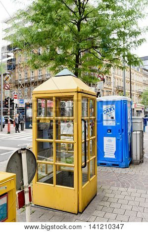 LUXEMBOURG LUXEMBOURG - Post Luxembourg yellow phone booth in the center of Luxembourg. Former Entreprise des Postes et Telecommunications branded as POST Luxembourg and abbreviated to POST is a mail and telecommunications semi government-owned corporatio