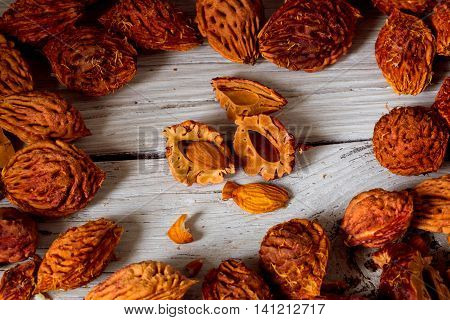 Beautiful Fruit And Lots Of Peach Pits From Peaches On Wooden Background