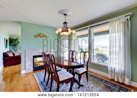 Antique Dining Area With Wooden Table Set, Hardwood Floor And Rug