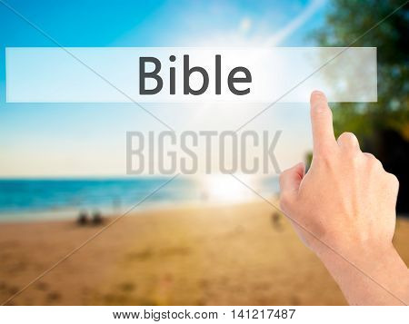 Bible - Hand Pressing A Button On Blurred Background Concept On Visual Screen.