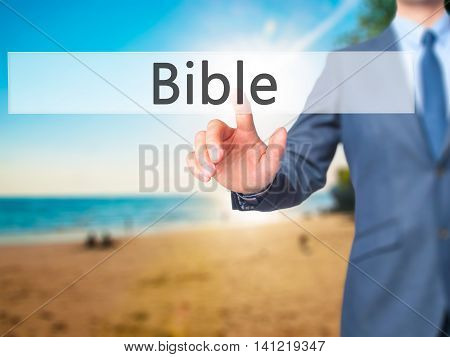 Bible - Businessman Pressing Virtual Button
