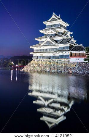 Matsumoto castle (Matsumoto-jo) historic landmark at night with beautiful reflection in water in matsumoto city nagano Japan.