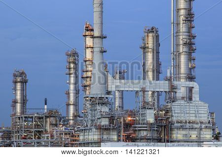 oil refinery palnt against dusky blue sky in petrochemical industry estate