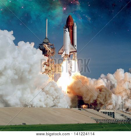 Space Shuttle Discovery launches from NASA Kennedy Space Center Launch Pad. Elements of this image furnished by NASA.