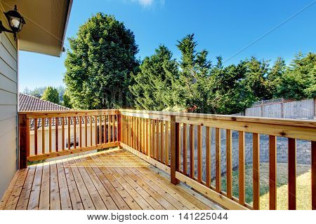 Unfurnished Small Walkout Deck With Backyard View.
