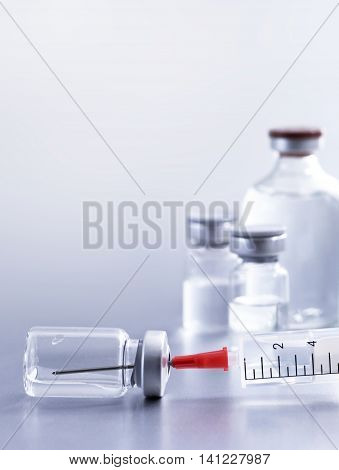 Syringe and vials. Medical eqipment, studio shot with copy space.