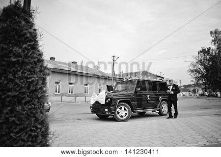 Stylish Groom Near Maffia Car At Wedding Cortege