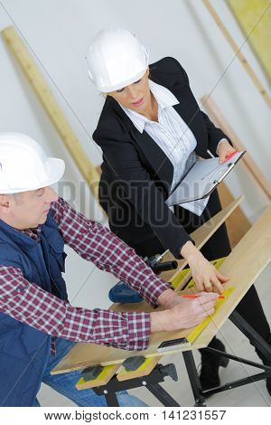 experienced female worker supervising her apprentice