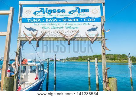 MONTAUK, LONG ISLAND, US, JUNE 18, 2016: Montauk Lake and marina - advertisement of fishing charter boat