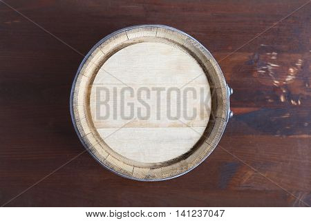 Farm concept. Closeup of oak barrel top. Nice wooden background