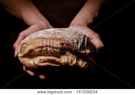 Baker Man Holding A Round Bread