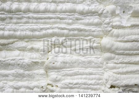 Foam construction.Thermal and hydro insulation with spray foam at house construction site