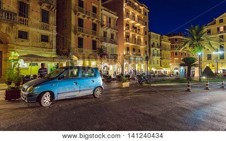 Corfu, Greece - July 6, 2011: Native People And Tourist Walking On The Streets Of City At Night