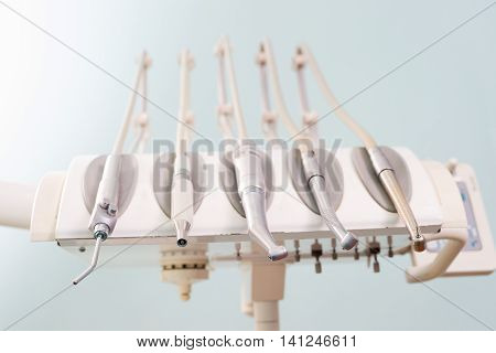 Stomatological instrument in the dentists clinic. Dental background: work in clinic. Operation, tooth replacement.