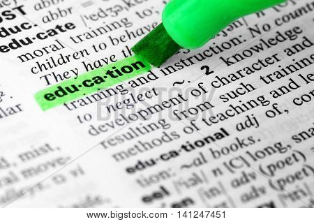 Close Up of Highlighting Specific Word Educiation in a Dictionary