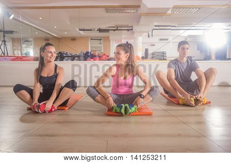 Three Young People Group Fitness Gym Relaxing Sitting Mat