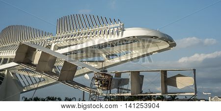 Rio de Janeiro Brazil July 23 2016: Model of the famous glider of aviator Santos Dumont was installed in front of the Tomorrow's Museum designed by architect Santiago Calatrava was inaugurated by Brazilian President as part of a program for the Rio 2016 O