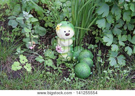 Caterpillar garden ornament decoration in summer grass