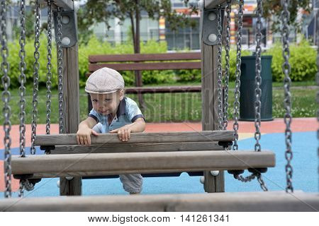 Child Climbing Wooden Obstacle