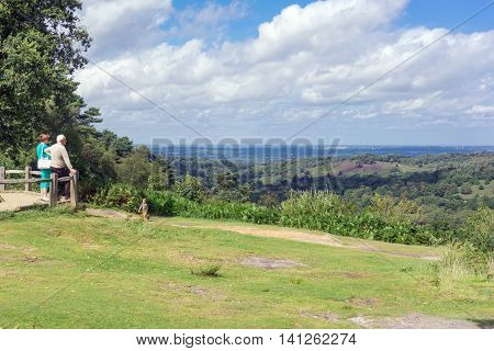 Himdhead/UK. 3rd July 2016. Day tourists admire the natural terrain of the Devil's Punchbowl at Hindhead in Surrey