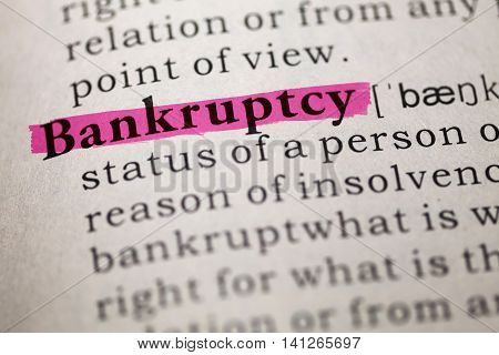 Dictionary definition of the word Bankruptcy. close up