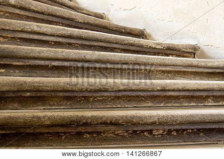 Steps of wooden stairs in Pieskowa Skala - Poland.
