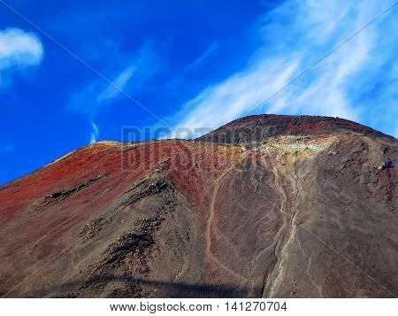 A volcano with lava flow patterns and erosion