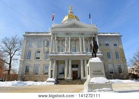 New Hampshire State House in winter, Concord, New Hampshire, USA. New Hampshire State House is the nation's oldest state house, built in 1816 - 1819. poster