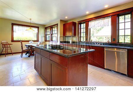Kitchen With Island And Dark Wood Floor.