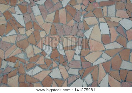 Brown tile mosaic texture. Vibrant mosaic of tiles as a background image. Pastel beige mosaic background. Background of brown and white mosaic tiles in a pattern.