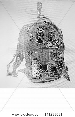 the photographer's backpack under a X-ray. check of baggage at the airport.Camera and lenses. check of baggage at the airport. black and white.