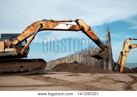 Excavator Build Breakwater At Beach