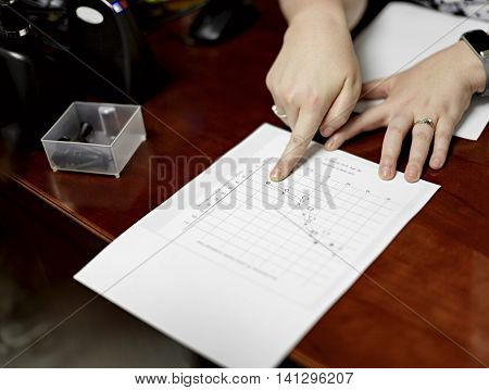 Hands of a female doctor explaining hearing test results