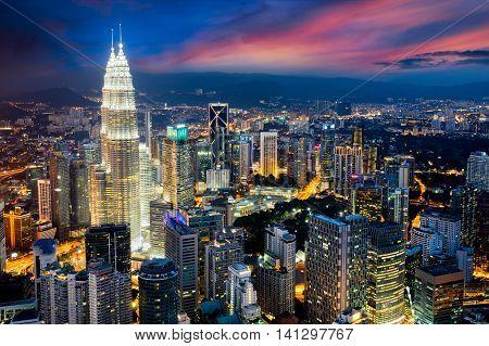 Kuala lumpur city skyline at dusk Kuala lumpur is capital city of malaysia Business district area in Kuala lumpur Malaysia