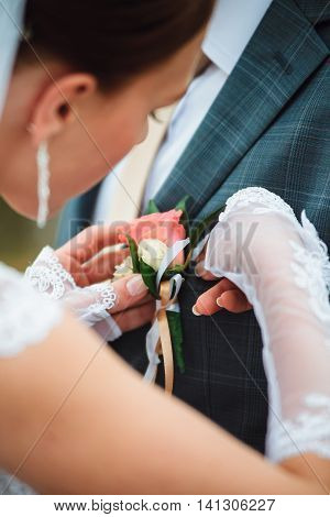 Bride Wears A Buttonhole