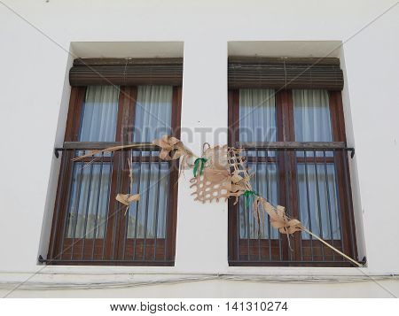Decorative palm frond in window in Jewish quarter of Jaen Andalusia