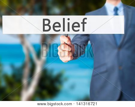 Belief - Businessman Hand Holding Sign