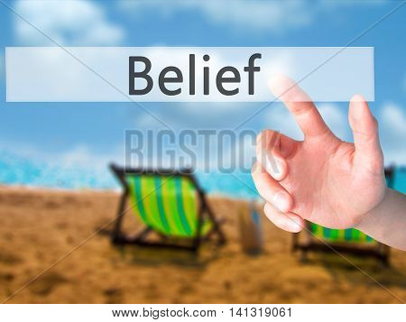 Belief - Hand Pressing A Button On Blurred Background Concept On Visual Screen.