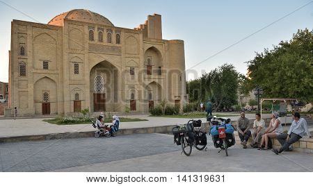 Bukhara Uzbekistan - 05 August 2015: Foreign tourists and locals in the squares and streets of ancient Bukhara in Uzbekistan.