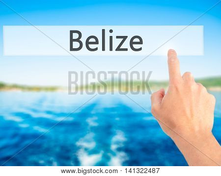 Belize - Hand Pressing A Button On Blurred Background Concept On Visual Screen.