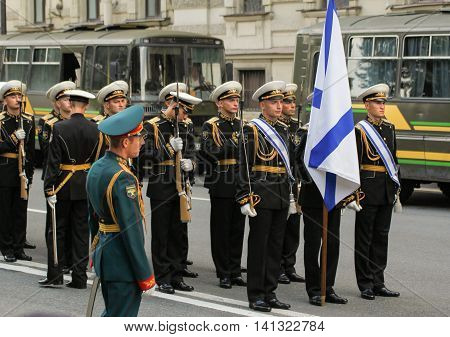 St. Petersburg, Russia - 31 July, The commander of a platoon of the military near the flag, 31 July, 2016. Military sailors on parade in honor of the Navy.