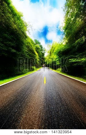 Country road between district to the city, Journey way of traveller to the nature, Road in the mountain and the forest for travel to someplace, Highland road or asphalt road in the forest and no car.