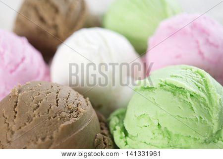 Close up assorted ice cream scoops.